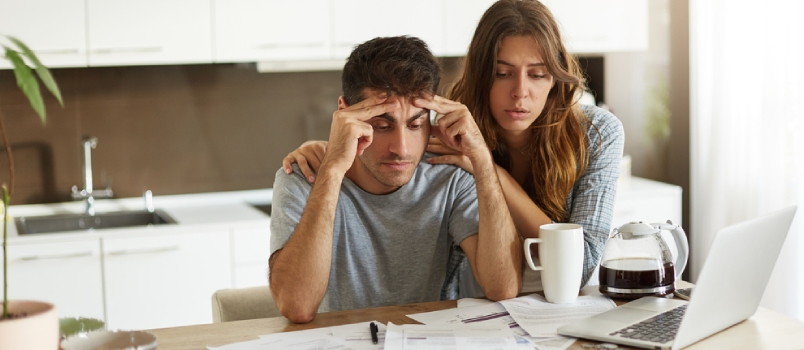 Financial Stress And Economic Crisis Young Caucasian Man Feeling Depressed While His Wife Trying To Cheer Him Up