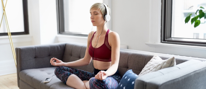 Beautiful Women Meditation At Home With The Headphone