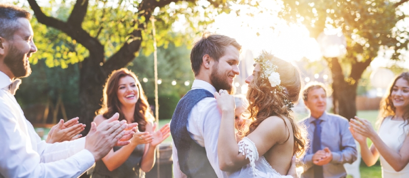 Bride And Groom Dancing At Wedding Reception Outside In The Backyard