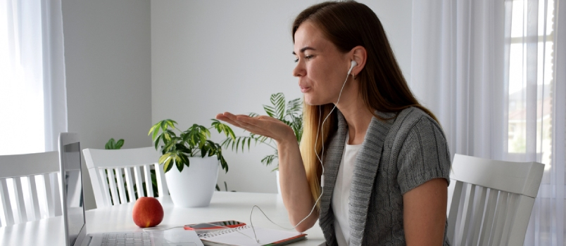 Woman In Love With Long Hair In Gray Cardigan Sending Air Kiss Through Computer Screen While Online Meeting Showing Miss You