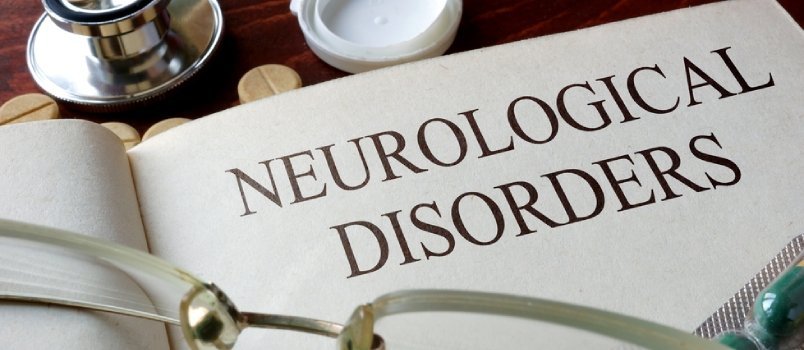 Neurological Disorder Text With Glasses And Doctor Stethoscope On Table