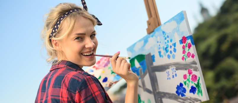 Beautiful Blonde Woman Artist Paints A Colorful Picture