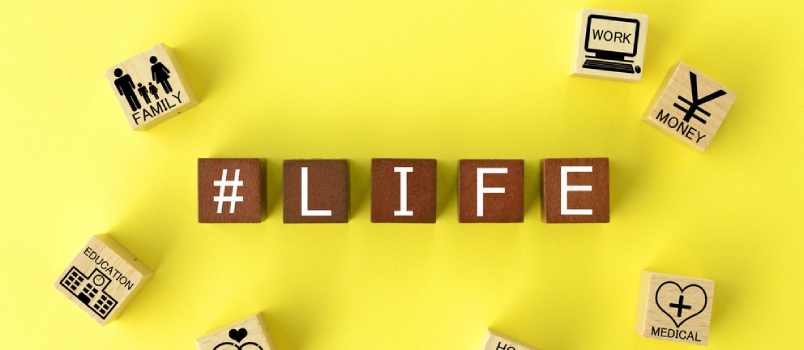 Wooden Blocks With Various Life Events On Yellow Background