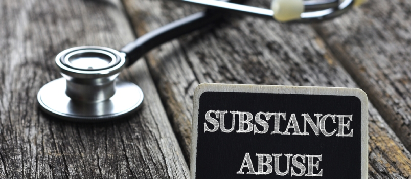 Substance Abuse Board With Stethoscope On Wooden  Table